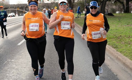 a trio of women running